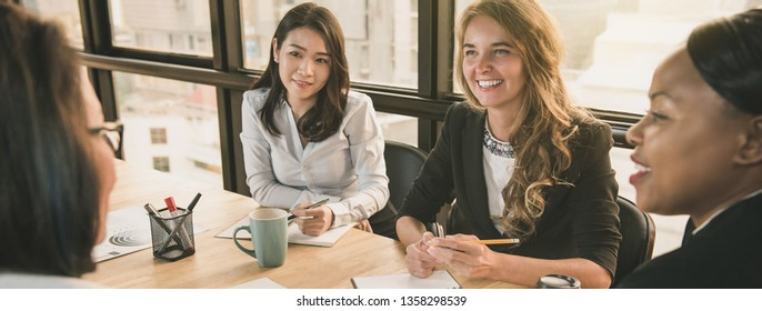 Japanese businesswoman having a meeting with international team, diverse female leader concept, banner size