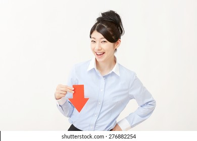 Japanese businesswoman pointing down
