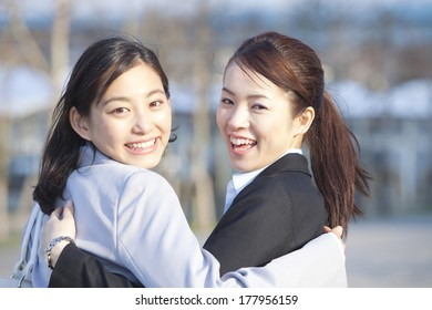 Japanese businesswoman turning around while snuggle