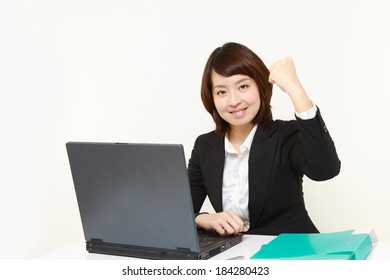 Japanese businesswoman in a victory pose