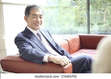 Japanese CEO sitting on the sofa