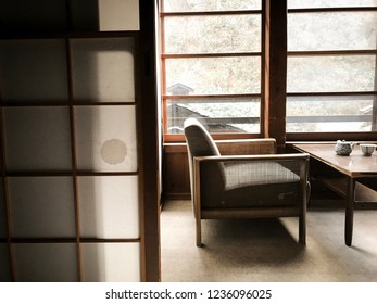 Japanese chairs and table for tea time in ryokan room in the autumn seasons and Japanese culture
