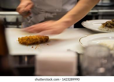 Japanese chef chopping the tonkatsu