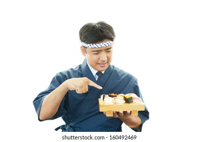 Japanese chef with Sushi set