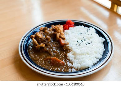 Japanese chicken curry with rice on wooden table in Japanese restaurant. Japanese food. Katsu