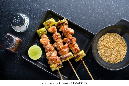 japanese chicken grill  Yakitori set with ingredient in dark tone low lighting and dark shadow concept and space for text.