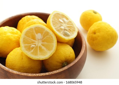 Japanese citrus fruits, Yuzu in wooden bowl with copy space
