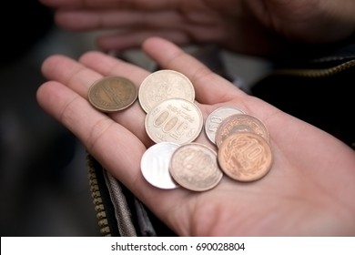 Japanese Coins in the Tourist's Hand. (Selective Focus)