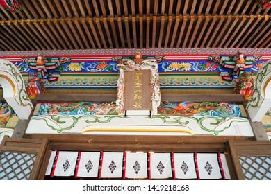"Japanese colorful shrine architecture. Japanese text on center sign is ""Hotosan Jinja Shrine (Shrine name)"". At Chichibu, Saitama, Japan."