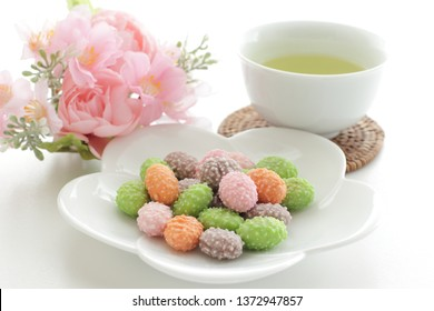 Japanese confectonery, colorful almond candy and tea