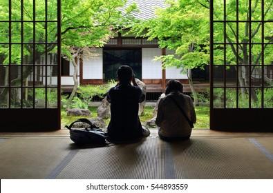 Japanese couple contemplating zen garden in Kyoto (Kennin-ji)