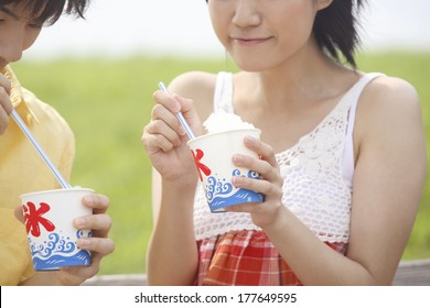 Japanese Couple eating shaved ice with syrup