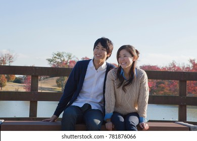 Japanese couple to enjoy the fall foliage