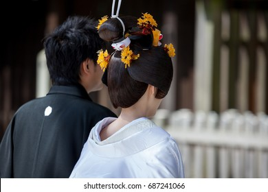 Japanese couple getting married in a temple in Tokyo.
