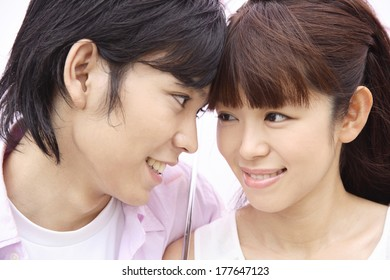 Japanese Couple putting heads together