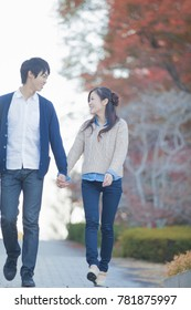 Japanese couple standing in park