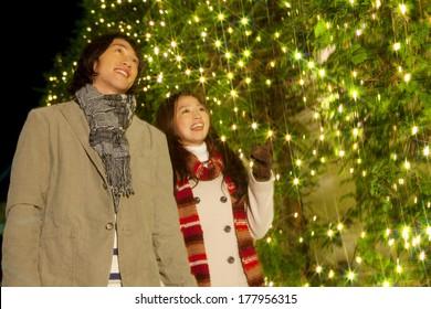 Japanese Couple walking while watching the Christmas illuminations