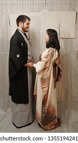Japanese Couple Wearing Kimono Standing. face to face. bride and groom holding hands after they got married and the wear kimono (Japanese style)