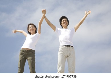 Japanese Couples waving hands