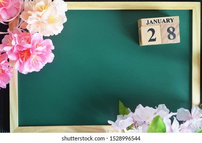 Japanese Cover, Number cube with of date sakura flower on the wood green board, January 28.