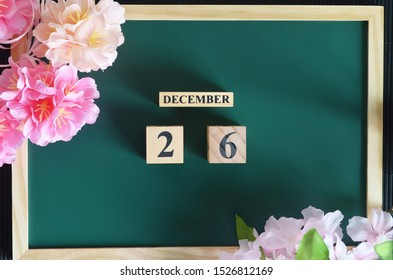 Japanese Cover, Number cube with sakura flower on the wood green board, December 26.