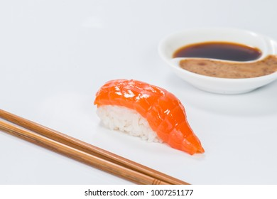 Japanese cuisine. Appetizing salmon and rice on light background