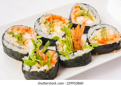 Japanese cuisine fried shrimp sushi roll with seaweed and rice.