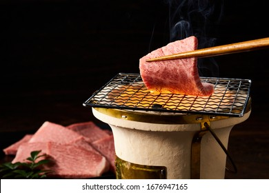 Japanese cuisine, grilled beef on wooden tabletable