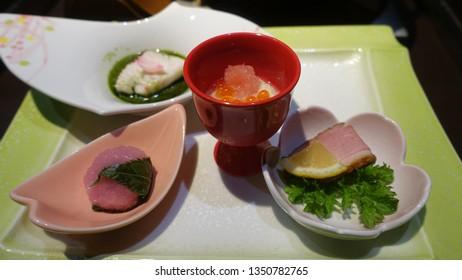 Japanese cuisine image, traditional food Kaiseki dinner set on colorful traditional plates