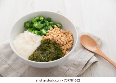 Japanese cuisine: Nebaneba (sticky) Rice Bowl -- Warm steamed rice topped with natto , boiled okra, tororo (grated long taro or Japanese mountain yam) and mekabu (a type of tender wakame seaweed).