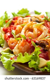 Japanese Cuisine - Noodles with Seadood and Tomato Sauce. Garnished on Salad Leaf with Cherry Tomato