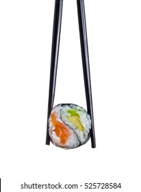 Japanese cuisine. One peace of sushi roll in black chopsticks isolated on white background. Yin Yang.