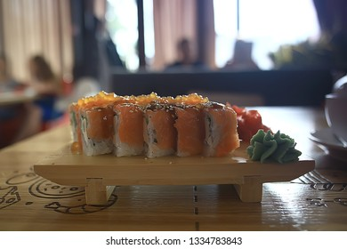 Japanese cuisine / Philadelphia rolls with salmon, and table setting in a traditional restaurant