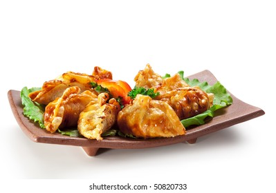 Japanese Cuisine - Pork (or Seafood) Dumplings (gyoza). Garnished on Salad Leaf with Pepper and Fresh Parsley