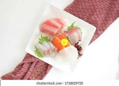 Japanese cuisine, raw fish Sashimi on dish