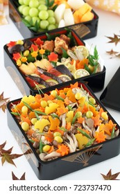 Japanese cuisine, Rice seasoned and cooked with mushrooms, topped with  autumn leaf shaped  autumn vegetables.