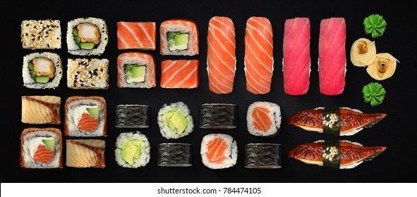 Japanese cuisine. Sushi with fresh ingredients over black background.