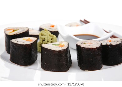 Japanese Cuisine : Sushi Maki Roll with Salmon and tuna inside . on white dish with sticks isolated over white background