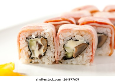 Japanese Cuisine - Sushi Roll with Mushrooms, Cheese and Cucumber inside. Bacon outside
