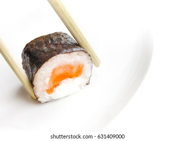 Japanese cuisine. Sushi roll on a white background.