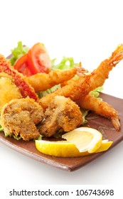 Japanese Cuisine - Tempura Food: Deep Fried Shrimps, Vegetables and Mushrooms