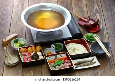 japanese cuisine, udon suki, hot pot with udon noodles and fresh vegetables and seafood