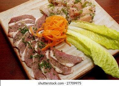 """Japanese cuisine - """"Yakiniku"""" which means """"grilled meat"""". In yakiniku restaurants, diners order raw ingredients which are then cooked by the diners on a grill built into the table."""