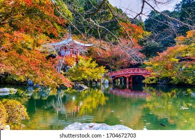 Japanese Cultural Heritage. Serene Famous Daigo-ji Temple During Beautiful Red Maples Autumn Season at Kyoto City in Japan. Horizontal image