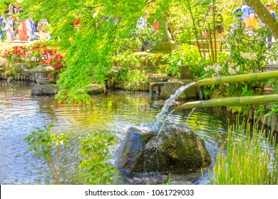 Japanese culture concept. Close up of traditional japanese bamboo fountain in Hase-dera garden. Kamakura, Japan. Japanese temple and buddhism concept.