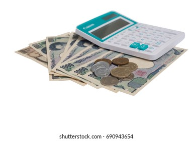 Japanese currency yen bank notes with  Japanese yen coin and calculator on white background.