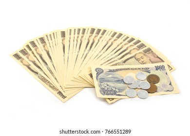 Japanese currency yen banknotes and coin on white background.
