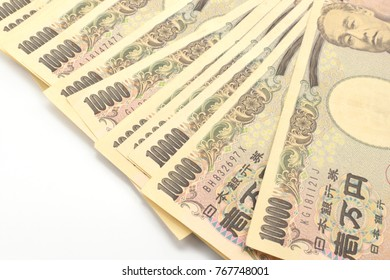 Japanese currency yen banknotes on white background.