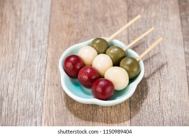 Japanese Dango dessert with 3 different color in pink(red), white, and green, recipe, hanami Dango, tsukimi Dango, copy space.