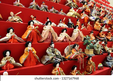 Japanese decorate dolls called Hina Ningyo (hina dolls) in March. Hina Ningyo represents the Emperor, Empress, their servants and so on.